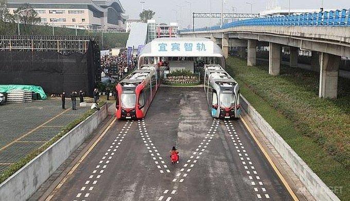 Первый безрельсовый китайский поезд перевез первых пассажиров (3 фото)